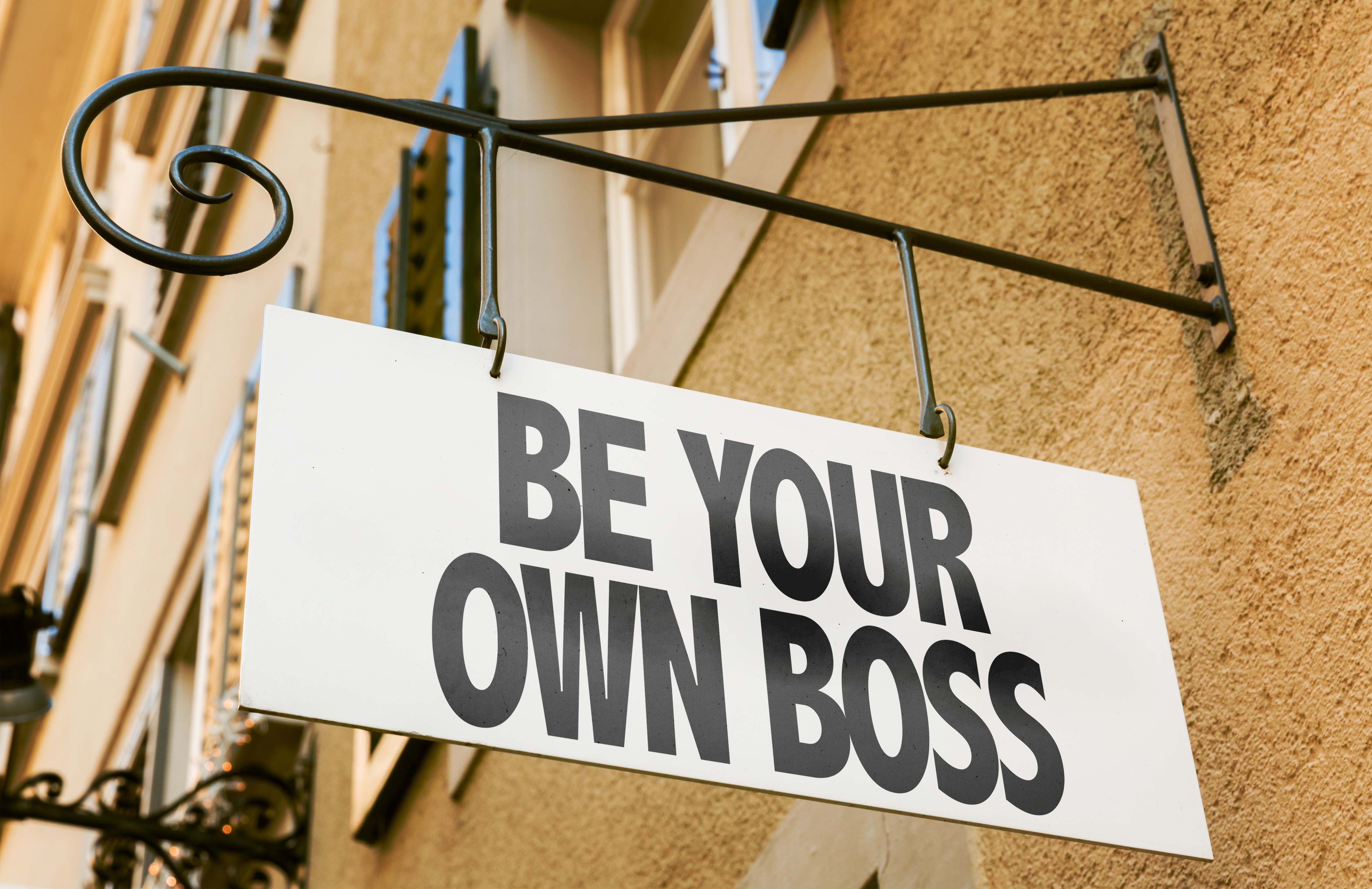 Be Your Own Boss sign in a conceptual image